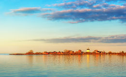 Phare dans le coucher du soleil Photographie stock