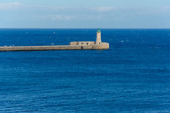 Phare dans le port grand, La Valette, Malte Images stock