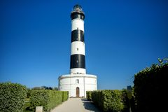 Phare de Chassiron. Island D`Oleron. France. Phare de Chassiron. Island D`Oleron in the French Charente with striped lighthouse. France. Top of the lighthouse royalty free stock images