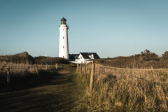 Phare de Hirtshals Fyr dans le paysage du nord du Danemark dans le coucher du soleil Photos libres de droits