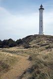 Phare de Lyngvig dans le paysage côtier du Danemark Images stock