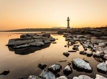 Phare de Paquis au lever de soleil, Genève Image libre de droits