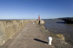 Phare de port de jetée de pilier Images libres de droits