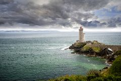 View of the Phare du Petit Minou in Plouzane, Brittany, France. The Phare du Petit Minou is a lighthouse in the roadstead of Brest, standing in front of the Fort royalty free stock photo