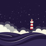 Phare en mer de nuit. Photo stock