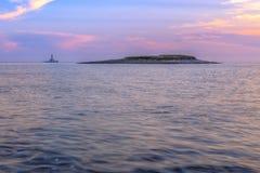 Phare en mer orageuse, Porer droite Kamenjak photo libre de droits
