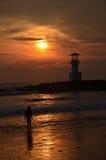 Phare et coucher du soleil Photographie stock