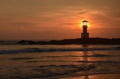 Phare et coucher du soleil Photos libres de droits