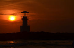 Phare et coucher du soleil Photos stock