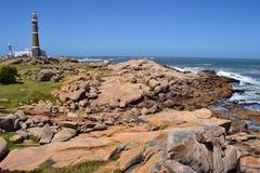 Phare et roches Photos libres de droits