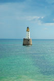Phare lointain Photographie stock
