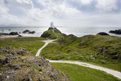 Phare sur la côte Photos stock