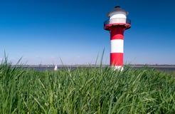 Phare sur la digue en Allemagne Photographie stock libre de droits