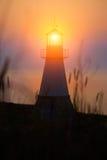 Phare sur le coucher du soleil Photo libre de droits