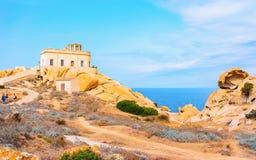 Phare sur le Testa de capo en Santa Teresa Gallura Sardinia Italy photo libre de droits