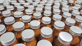Pharmaceutical bottles. Brown Bottles in medicine factory. Horizontal composition Royalty Free Stock Photo