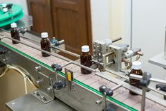 Pharmaceutical brown glass bottle production line Royalty Free Stock Images