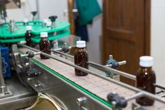 Pharmaceutical brown glass bottle production line Stock Photos