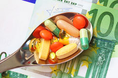 Pharmaceutical business concept. Money and pills royalty free stock images