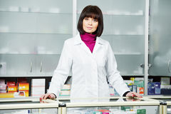 Pharmaceutical chemist woman in drugstore Royalty Free Stock Photo