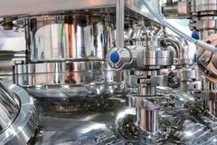 Pharmaceutical equipment, a lot of metal nipples and flanges. Stock Image