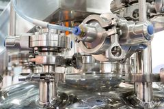 Pharmaceutical equipment, a lot of metal nipples and flanges. Stock Photos