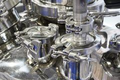 Pharmaceutical equipment, a lot of metal nipples and flanges. Stock Photo