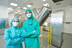 Pharmaceutical factory workers stock photos
