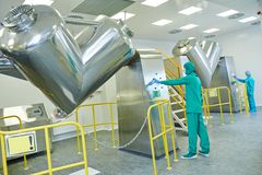 Pharmaceutical factory workers Stock Images
