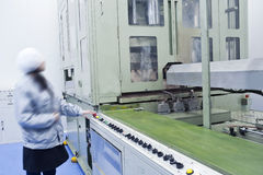 A pharmaceutical female technicians in the machine Royalty Free Stock Photography