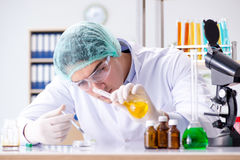 The pharmaceutical industry concept with scientist in the lab Royalty Free Stock Images