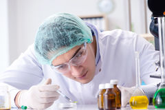The pharmaceutical industry concept with scientist in the lab Stock Photo