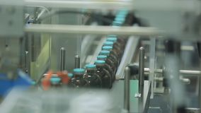 Pharmaceutical industry. Production line machine conveyor at factory with bottles. pharmaceutical production of liquid Royalty Free Stock Images