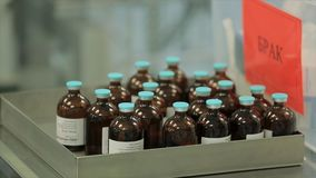 Pharmaceutical industry. Production line machine conveyor at factory with bottles. pharmaceutical production of liquid stock photo