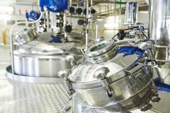Pharmaceutical industry worker. Pharmaceutical factory equipment mixing tank on production line in pharmacy industry manufacture factory Stock Photography