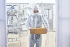 Pharmaceutical Lab Worker Carrying Box stock images