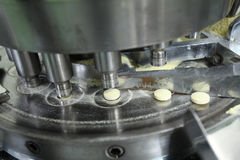 Pharmaceutical machine operating Stock Photography