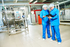 Pharmaceutical male workers in water preparation production line Stock Images