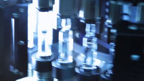Pharmaceutical quality control of medical vial. Quality control of glass ampules. Pharmaceutical quality control of medical vials. Ultraviolet light in control stock video footage