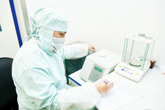 Pharmaceutical researcher working with digital scales in laboratory Stock Photo
