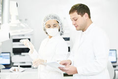 Pharmaceutical staff workers in uniform at laboratory Royalty Free Stock Photography