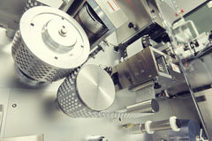 Pharmaceutical tablet pill production. blistering packing machine Royalty Free Stock Photos