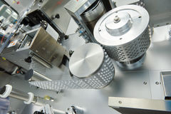 Pharmaceutical tablet pill production. blistering packing machine Stock Photography