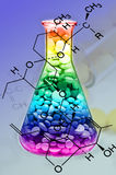 Pharmaceutical Technology. Mixed Tablet Dosage Form in the Erlenmeyer Flask and Chemical Structure in New Drug Discovery Concept and Pharmaceutical Technology Stock Images