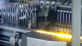 Pharmaceutical vials glass furnace. Medical ampoules manufacturing process stock video
