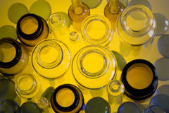 Pharmaceutical vials in yellow. Top view of some kind of pharmaceutical vials Stock Photos