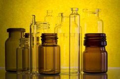 Pharmaceutical vials in yellow  Royalty Free Stock Image