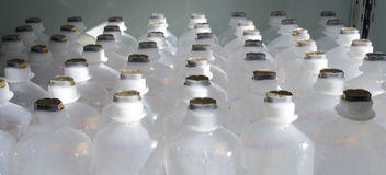 In the pharmaceutical warehouse. Rows of plastic bottles Royalty Free Stock Photography