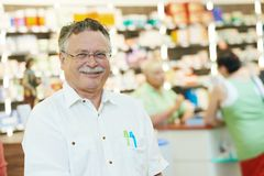 Pharmaceutical worker in drugstore Stock Image