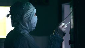 Pharmaceutical worker operating production line. Worker using touch screen panel stock footage